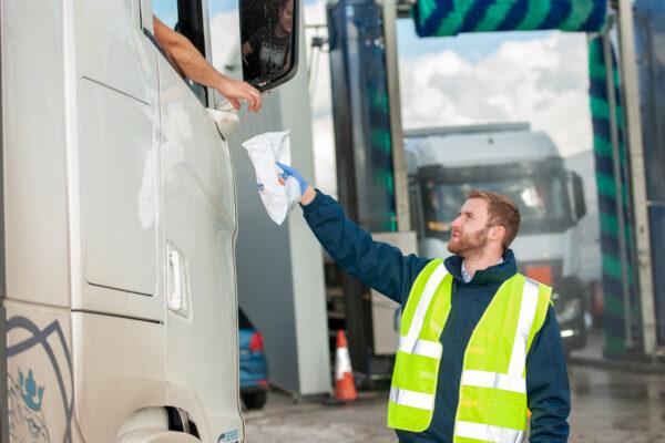 D4Drivers handing merchandise to HGV driver